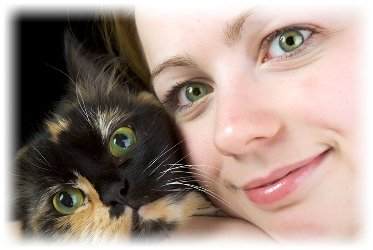lady and cat looking into camera